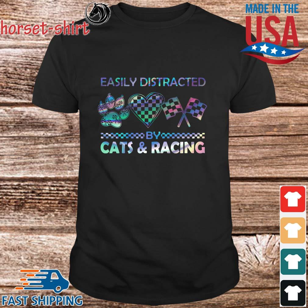 Easily distracted cats and racing shirt